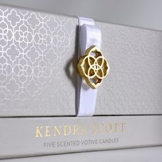 Repeating design elements come together in this Kendra Scott candle box to solidify true brand harmony. Corporate Design, Branding Design, Design Packaging, Identity Branding, Brochure Design, Visual Identity, Cosmetic Packaging, Jewelry Packaging, Kendra Scott