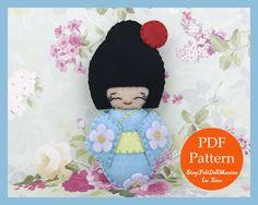 A personal favorite from my Etsy shop https://www.etsy.com/listing/514316790/japanese-kokeshi-doll-blue-felt-doll-pdf
