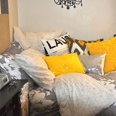 Gray and yellow pillows... Get Preppy College Dorm Room Ideas like this on Uscoop.com!