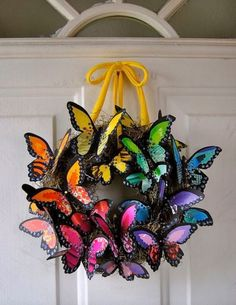 Craft store butterflies hot glued to a pre-made wreath.