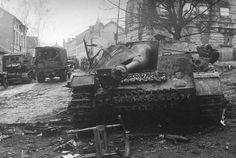 Broken German assault gun StuG IV in the streets of the town of Allenstein (now Olsztyn, Poland). East Prussia. The 2nd Belorussian front. 1945.