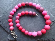 Polymer clay and sterling silver beaded necklace in bright pinks £40.00