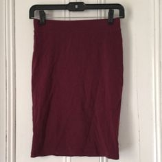 Forever 21 pencil skirt Forever 21 stretchy pencil skirt. Burgundy in color. Size S. Pull on style with elastic waist. Forever 21 Skirts Pencil