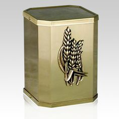 The Victorious Wheat Bronze Cremation Urn is made in an octagonal shape from finest bronze alloys. The Urn is accented with a beautiful wheat appliqué and finished to the perfect shine. A true piece of art that can be displayed in any mausoleum or home to create the perfect resting place.   Bottom opening base attaches with screws.