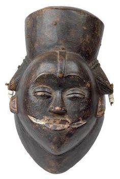 Punu, Gabon: A rare, black Punu mask, called 'Ikwara mask'. African Masks, African Art, Spiritual Background, The Mask Costume, Arched Eyebrows, Light Colored Wood, Masks Art, Black Mask, Tribal Art