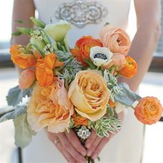 Here a spin on a traditional bouquet with lovely orange flowers.