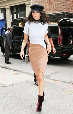 Kendall Jenner makes a pencil skirt feel youthful with a basic white tee, choker, and velvet boots