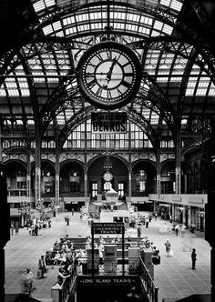 GREAT TRAIN STATION: Old Penn Station circa 1910. Large Benrus sponsored clock overlooks.The most recent Madison Square Garden is now here.