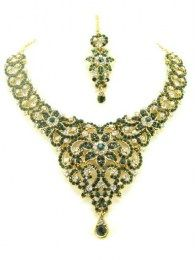 Flower Design In This Necklace Set With Green Color Stones Embedded In It
