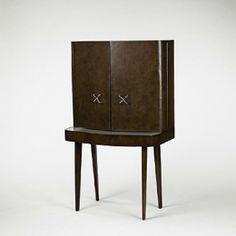 George Nelson; Walnut, Leather, Glass and Metal Vanity for Herman Miller, 1948.