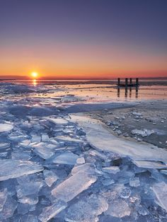 Cold Lake - This Picture was taken on Lake Neusiedlersee in Burgenland/Austria. Sometimes, when the wind is very strong, it pushes the ice to the shores, where it cracks and then you can find the different ice formations Austria, Switzerland, Winter, Sunrise, Photos, Pictures, Strong, Ice, Cold