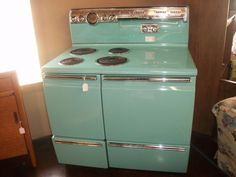 Vintage 1955 GE Stove.  All the meals I ate as a child, Earnie cooked from a white stove just like this.