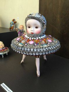 A lot of people on earth believe that alien beings live and work with us, undetected by anyone. Found Object Art, Found Art, Creepy Dolls, Doll Parts, Assemblage Art, Doll Head, Weird And Wonderful, Bead Art, Unique Art