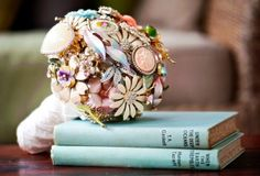 Check this out, brooch bouquets, what a great idea for up-cycling. A must for every eco bride!