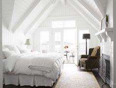 crisp white bedding, velvet chair, beams
