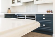 The Worktops are a soft grey to complement the blue units and are an exquisite CRL Verona quartz with a rich OGEE Edging which gives the worktop a really luxurious touch. #mackintosh #kitchen #worktop #kitchenworktop #quartz #OGEE