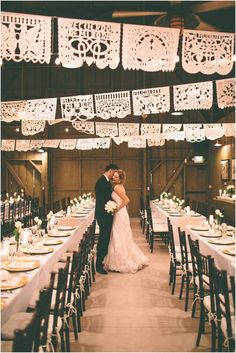 Mexican gold, ivory, white, pink wedding inspiration with white papel picado, long feasting tables with DIY lace runners