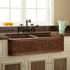 """Wow! Came across this website while looking to replace my sink and wanting a farmhouse sink. So many unusual sinks offered, including this 33"""" Vine Design 60/40 Offset Double-Bowl Copper Farmhouse Sink. Wish I could afford it. An alternative I might consider is getting the single 33""""sink with the same design and putting 2 small rubber/plastic tubs inside to separate a soapy water from a clean rinse water."""