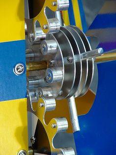 """Whirligig #63 9 3/4"""" x 19 1/2"""" x 19 1/2"""" (25cm x 49.9cm x 49.9cm), aluminum, assorted hardware, adhesive sign vinyl. Detail..."""