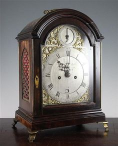 A George III ebonised pear wood hour repeating bracket clock, the arched silvered dial inscribed James McCabe, London, with later date aperture, twin fusee movement with verge escapement and bob pendulum with floral and figure engraved unsigned backplate, associated to case, 15.5in