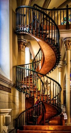 The Miraculous Staircase in the Loretto Chapel, Santa Fe, New Mexico. Completed in 1878, there was no way to access the choir loft twenty-two feet above. The Sisters of the Chapel prayed to St. Joseph. Legend has, a man appeared at the Chapel with a donkey and a toolbox looking for work. He built this staircase which has two 360 degree turns and no visible means of support. Once completed, the carpenter disappeared without pay. Many believe he was St. Joseph himself. | by Len Saltiel