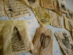 Used tea bags ~ dried, emptied, & stamped.  Blogger suggests using the removed tea leaves in the garden.  I <3 recycling & reusing  ;-)  #art #journal