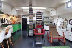 Amazing house boat interior….love the book storage!! :-)