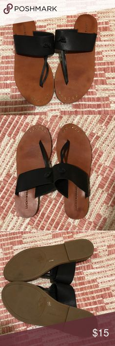 Luck Brand- Ari Flat Sandal Lucky Brand- Ari Sandal Premium leather slip on T-strap sandal. Has a 0.28 inch heel. Color is black with a natural color sole. Size is US 8.5. Have been worn and show slight signs of wear. Does not come with the box. Lucky Brand Shoes Sandals