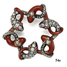 Broche de esmaltes y diamantes, formado serpientes. 1910