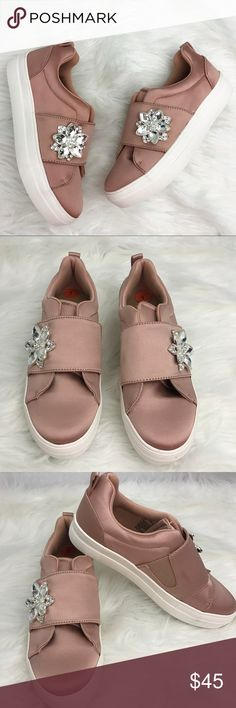 Madden Girl Adair Blush Satin Shoes Size 7 Beautiful blush satin sneaker shoes. Textile Upper with jeweled detailed. Slip-on construction. Round-toe. Soft fabric and synthetic lining. Lightly padded footbed. Durable rubber and fabric outsole. Brand new ( no box). Tiny stain on one spot ( as shown in photo ). Size 7. Madden Girl Shoes Sneakers