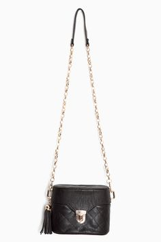 Quilted bags + tassles.