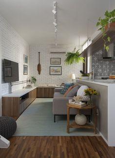 Tijolinhos brancos dão charme ao apartamento versátil