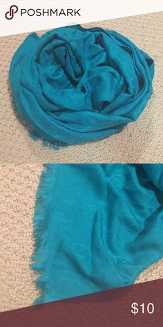 Calvin Klein Blue Scarf Blue scarf --- looks slightly more turquoise in person. CK design -- very subtle. Super silky soft. Fringe ends. Rectangular shaped. Pretty long. Never worn, it was a gift 😬 Calvin Klein Accessories Scarves & Wraps