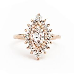Stunning double halo marquis engagement ring! So unique. <3