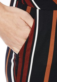 <li><p>Liven up your trouser collection with these candy stripe trousers from F&F. Cut in a slim leg fit, the trousers are finished with slip pockets at the hips and subtle pleating at the waistband.</p><p>Concealed button, hook, bar and zip fly fastening</p><p>Ankle length</p></li>