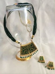 "✦✦.. Beautiful and handmade ""Thewa"" #jewelryset from Rajasthan in green and gold color. It contains pendant and earrings. Gift this unique jewelry to your loved one!!! ✦✦"