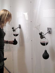 """The """"Smell Wall"""" is a clever design to learn to be a connoisseur of wine. The flask and pump can be easily used by all audiences without much thought. However the amount of reading and the minimalist design takes interest away and it takes out the educational element of the wall."""