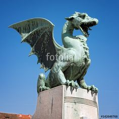 "Download the royalty-free photo ""Statue of dragon on the famous Dragon bridge (Zmajski most), symbol of Ljubljana, capital of Slovenia, Europe. "" created by goodcatfelix at the lowest price on Fotolia.com. Browse our cheap image bank online to find the perfect stock photo for your marketing projects!"
