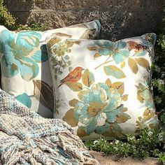 """Garden Magnolias pillow set ~ Garden magnolias bloom brightly on this pillow pairing; one bears only blossoms while its companion is accented with two colorful """"feathered guests"""". Take a glance at our Teal Velvet accent pillow for a bold pop of color . . . or, if you're feeling a little more reserved, our Taupe Velvet pillow is the perfect addition"""