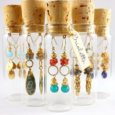 corked vial packaging, for earrings; miniature glass bottles with cork stoppers as jewelry display; Upcycle, Recycle, Salvage, diy, thrift, flea, repurpose!  For vintage ideas and goods shop at Estate ReSale & ReDesign, Bonita Springs, FL