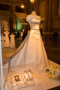 The wedding dress of Princess Victoria of Sweden designed by Par Engsheden is seen on display during an exhibition at the Royal Palace on October 17, 2016 in Stockholm, Sweden.