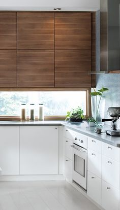 white kitchen cabinets and floors; transom windows; wood accent island and top cabinets (SOFIELUND cabinets)