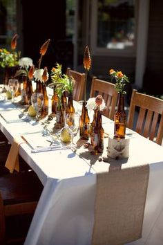 You don't often see brown but these look great! Beer-Bottle-Centerpiece-2