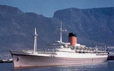 Pendennis Castle, maiden voyage Table Bay - Jan 1959 However she sailed into CapeTown with flags from mast to mast and tugs water spraying welcome.Arriving at the same time the Bloemfontein Castle, Merchant Navy, Merchant Marine, Beautiful Ocean, Vintage Travel Posters, Water Crafts, Titanic, Cape Town, Places To Visit, Odd Stuff