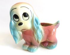 Hull Pottery Dog Planter. There is some question whether these are Hull, because they are unmarked. IMO, this is Hull, marketed to chain stores.