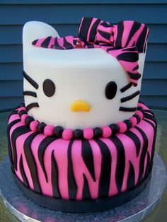 Zebra Print Hello Kitty Birthday Cake. Swirls of Very Cherry and Orange Creamsicle cake, filled with orange mousse & cherry mousse topped with Vanilla Buttercream frosting and covered in fondant with fondant decorations.