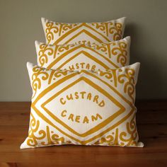 "Custard Cream Screen-Printed Cushion - etsy // would be cute to have one that says ""fish sticks and custard"""