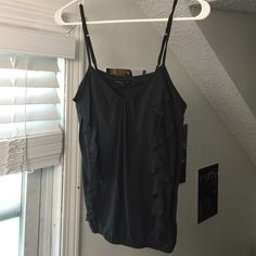 American Eagle tank top Loose tank top with two ruffles going down the front. Scrunched tight around waist. Adjustable straps American Eagle Outfitters Tops Tank Tops