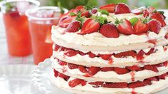 Fresh Strawberry Meringue Cake - Fresh & Juicy Strawberry Recipes - Southern Living - Recipe: Fresh Strawberry Meringue Cake  Securing parchment paper with masking tape (it won't melt at the low temp) makes it easy to spread picture-perfect layers of meringue.