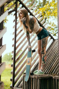 Lovely! #inked #girl #tattoo #skateboard